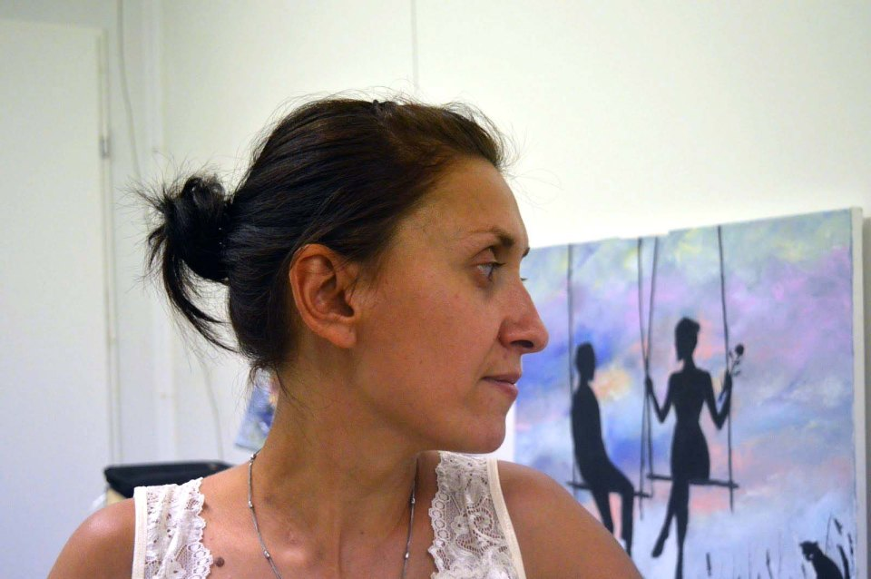Yuliya Kyrychenko and her drawing of a couple on the background. Photo: Olena Makarenko