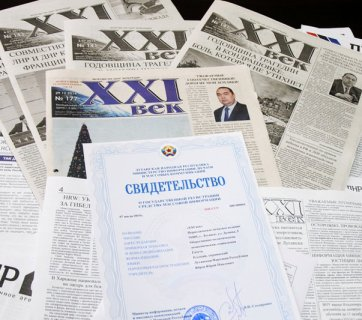 "Issues of the two remaining newspapers in Russia-occupied Luhansk. Its official ""LNR"" accreditation certificate is on top. Each issue features a prominent portrait of the head of the Moscow's puppet administration for the occupied territory. (Image: apostrophe.ua)"