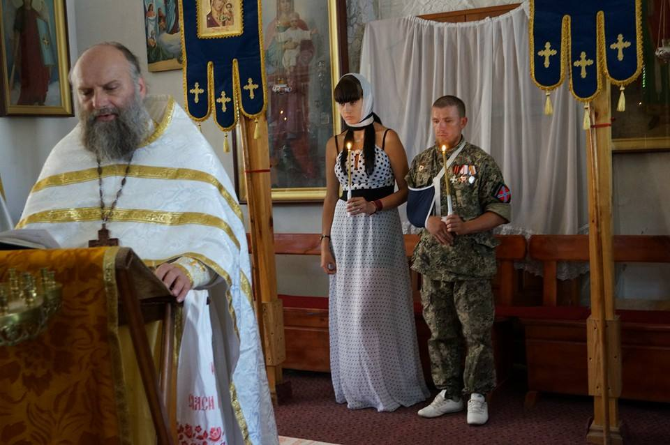 "Motorola's church wedding to his new and young Donbas ""wife"" when on a rehabilitation from a car accident injury in another Russia-occupied territory, Crimea. The ""wedding"" took place while his real wife and child were waiting for him in Russia (Image: social media)"