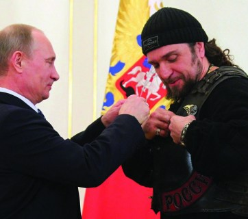 "Putin awards Russia's Order of Honor to the leader of a Moscow biker group financed by the Putin government Alexander Zaldostanov (aka ""the Surgeon""). The group serves important propaganda functions in the Russian hybrid war and actively participated in Putin's Anschluss of Crimea. (Image: Mikhail Klimentyev/RIAN)"