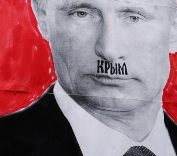 "The word ""Crimea"" written on Putin's upper lip to draw a parallel between his occupation of Crimea and Hitler's anschluss of Austria."