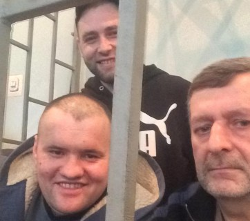 Akhtem Chiygoz, Ali Asanov, and Mustafa Dehermendzhy are jailed for participating in a rally in support of Ukraine's territorial integrity on 26 Feb. 2014. Photo: krymsos.com