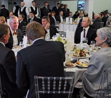 "Donald Trump's former national security advisor, former Director of US Defense Intelligence Agency, retired Lieutenant General Mike Flynn at a conference and gala dinner celebrating the 10th anniversary of Russia's propaganda arm, media channel ""RT"" (formerly ""Russia Today"") seated at the head table at the gala, with Vladimir Putin, his then-chief of staff, Sergei Ivanov and press spokesman Dmitry Peskov, among other Russian officials. Also seated at the same table is 2016 Green Party candidate for US president Dr. Jill Stein. December 10, 2015 in Moscow. (Image: video capture)"