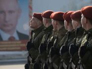 Soldiers of the National Guard of Russia (aka Russian Guard), an internal security structure subordinated to Putin personally, in formation in front of his portrait