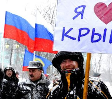 Russians celebrating the occupation of Crimea (Image: TASS)