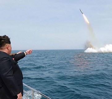 "Kim Jong Un, the ""Supreme Leader"" of North Korea, supervises the April 22 test-launch of a missile from a submerged platform. (Image source: KCNA)"