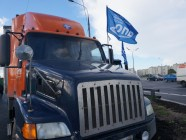 Long-haul truck with a flag of the Carrier Union of Russia
