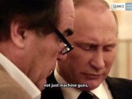 "Russian president Vladimir Putin and cinematographer Oliver Stone at the Kremlin in 2017. Putin shows Stone fake footage of a ""Russian helicopter bombing ISIS,"" which in actuality was footage of U.S. forces fighting the Taliban in Afghanistan in 2013 (Image: video capture)"