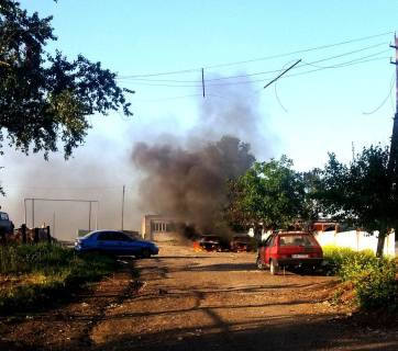 Cars in Sartana, a suburb of the seaside city of Mariupol, set ablaze by the shelling of Russian-hybrid forces. Photo: FB ato.news