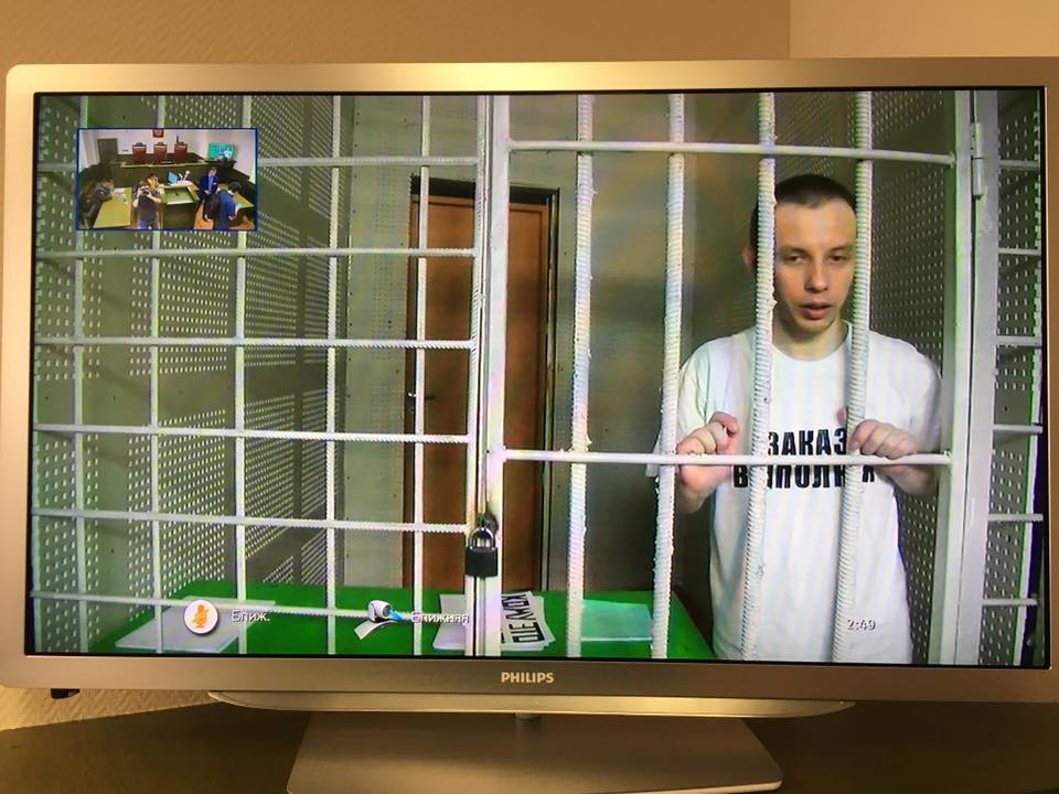 "Ruslan Zeytullaev wears a t-shirt with the inscription ""Order is fulfilled"" on the day of his trial"