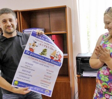 Secretary of the contest committee Iryna Dudulyak congratulates Artem Butov.