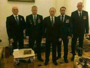 "Russian president Vladimir Putin pictured with Dmitry Utkin (""Vagner"") on the far right and other commanders of the Vagner private military company that fights on orders of the Russian military in Ukraine and Syria, but is not a part of it formally. This image is believed to date from December 2016."