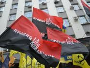 "The red-black flag, considered to be the unofficial flag of the Organization of Ukrainian Nationalists, has been adopted by the Right Sector, but is not welcome in Poland, where recently adopted historical memory laws outlaw the ""propagation of banderism."" Photo: pravyysektor.info"
