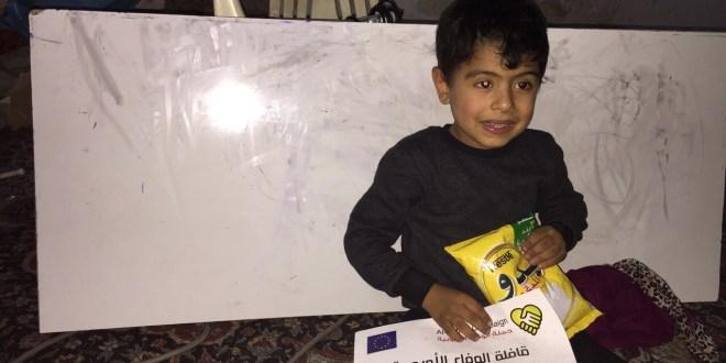 حملة الوفاء الأوروبية توزع حليب للأطفال