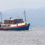 Glen Tarsan anchored off the Isle of Staffa with a misty Mull in the background