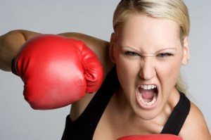 bigstock-Aggressive-Woman-Boxing-12038132-1024x682