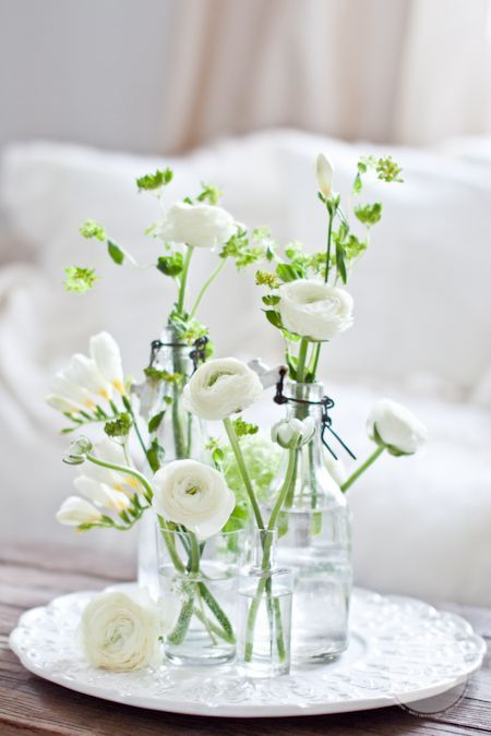 Guest Bedroom Inspiration Flower Arrangement White Flower Greenery Plants Floral Water Glass Vase White Comforter Cloud Simple