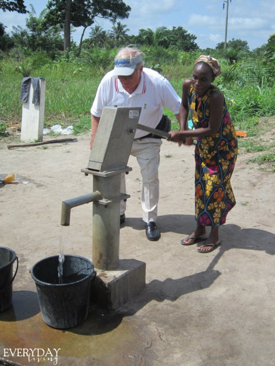 Brother Phillip Ellen pumping clean water with Mamma Yayra