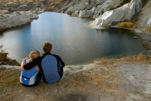 Couple looking down on Blue Lake, St Bathans