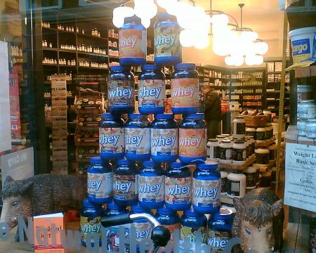 Cans of whey protein powder