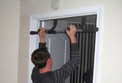 Home workout with door-mounted pull-up bar