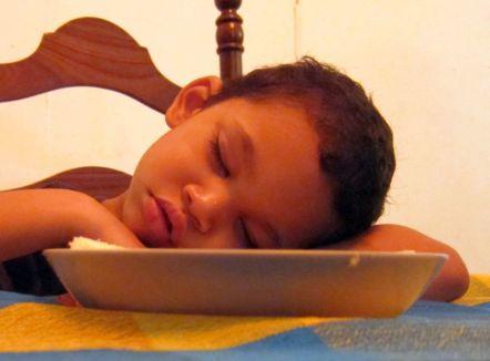 Boy sleeping at table