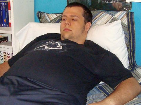Exhausted man lying on couch