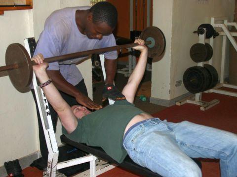 Man doing assisted benchpress