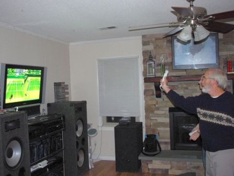 man playing wii tennis