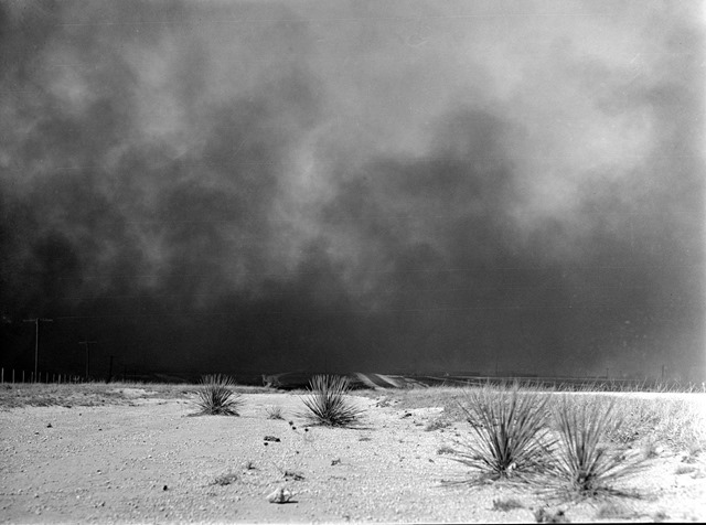 Heavy black clouds of dust rising over the Texas Panhandle, Texas; March 1936; photo by Arthur Rothstein.