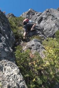 Ryan, ascending a the bushy gully toward the open book.