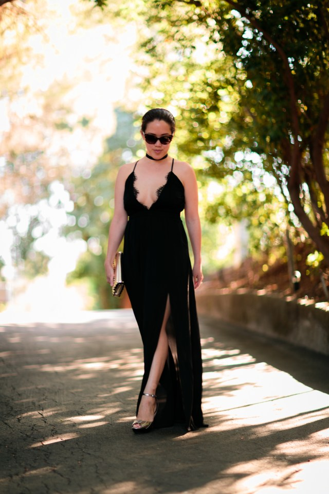 Black maxi dress with side slit and lace plunge v-neck by Tobi. Chanel sunglasses, Cole Haan gold heels, Valentino rockstud bracelet clutch