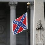 COLUMBIA, SC - JUNE 22:  The Confederate flag flies on the Capitol grounds after South Carolina Gov. Nikki Haley announced that she will call for the Confederate flag to be removed on June 22, 2015 in Columbia, South Carolina. Debate over the flag flying at the Capitol was again ignited off after nine people were shot and killed during a prayer meeting at the Emanuel African Methodist Episcopal Church in Charleston, South Carolina.   (Photo by Joe Raedle/Getty Images)