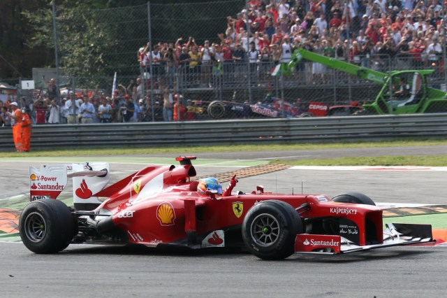 McLaren's Lewis Hamilton added the Italian Grand Prix to his list of Formula One victories on Sunday while Ferrari's Fernando Alonso stretched his overall championship lead to 37 points with 3rd place.