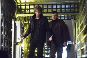 """The Flash -- """"Rogue Air"""" -- Image FLA122A_0366b -- Pictured (L-R): Liam McIntyre as Mark Mardon and Paul Anthony as Roy G. Bivolo -- Photo: Dean Buscher/The CW -- © 2015 The CW Network, LLC. All rights reserved."""