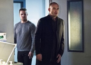 "Arrow -- ""Canary Cry"" -- Image AR419a_0169b.jpg -- Pictured (L-R) Stephen Amell as Oliver Queen and Paul Blackthorne as Detective Quentin Lance -- Photo: Dean Buscher/The CW -- �© 2016 The CW Network, LLC. All Rights Reserved."