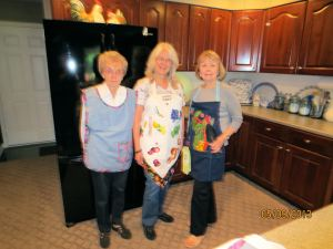 Pictured L to R: Connie Lutes, Barbara Carlson and Barbara Ferguson modeling their aprons.