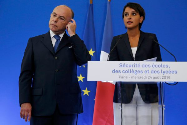 French Interior Minister Bernard Cazeneuve (L) and Education Minister Najat Vallaud-Belkacem attend a news conference to announce security plans for schools, in Paris, France, August 24, 2016.   REUTERS/Pascal Rossignol