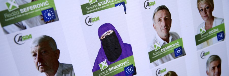 Picture of Indira Sinanovic, first Bosnian woman wearing the niqab to run in local election in Bosnia, is seen on an election poster in Zavidovici, Bosnia and Herzegovina, September 27, 2016. REUTERS/Dado Ruvic