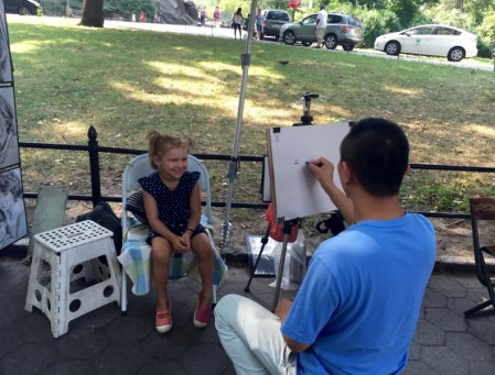 Central Park, caricature sitting