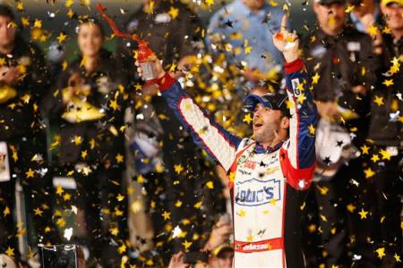 Jimmie Johnson, driver of the #48 Lowe's Patriotic Chevrolet, celebrates in Victory Lane after winning the NASCAR Sprint Cup Series All-Star race at Charlotte Motor Speedway on May 18, 2013  Photo - Geoff Burke