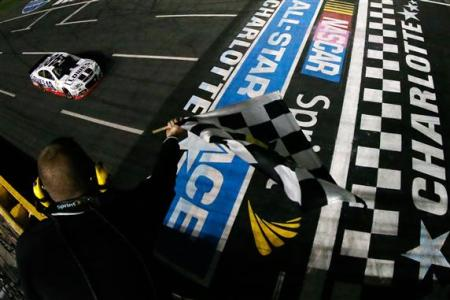 Jimmie Johnson, driver of the #48 Lowe's Patriotic Chevrolet, races to the checkered flag to win the NASCAR Sprint Cup Series All-Star race at Charlotte Motor Speedway on May 18, 2013  Photo - Jeff Zelevansky/Getty Images
