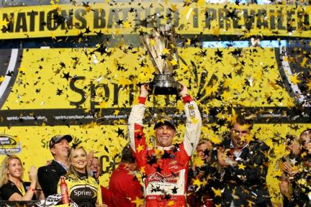Kevin Harvick, driver of the #4 Budweiser Chevrolet, celebrates in Victory Lane after winning the NASCAR Sprint Cup Series Ford EcoBoost 400 and the NASCAR Sprint Cup Series Championship at Homestead-Miami Speedway on November 16, 2014 Photo - Chris Graythen/Getty Images