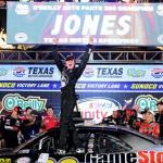 Erik Jones, driver of the #20 GameStop/Mortal Kombat X Toyota, celebrates in victory lane after winning the NASCAR XFINITY Series O'Reilly Auto Parts 300 at Texas Motor Speedway on April 10, 2015 Photo - Jared C. Tilton/Getty Images