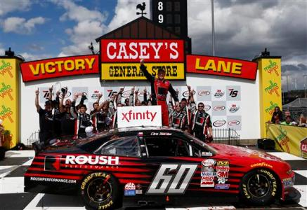 Chris Buescher, driver of the #60 Roush Performance Products Ford, celebrates in victory lane after winning during the NASCAR XFinity Series 3M 250 at Iowa Speedway on May 17, 2015 Photo - Jeff Zelevansky/Getty Images