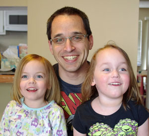 Andy Goldman and his twin daughters