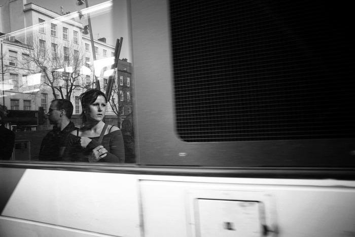 Girl reflecting on bus