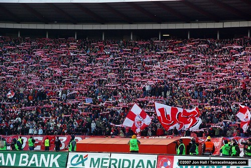 Red Star Belgrade fans waving scarfs