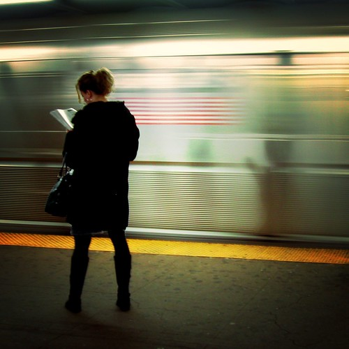 On the platform, reading