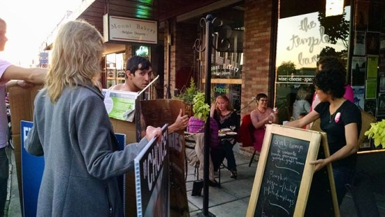"""Planned parenthood supporters follow ACP to third protest location, completely blocking signs and preventing our message from being seen by """"Pink Out"""" customers at the Temple Bar in Bellingham"""